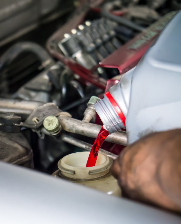 Hand pouring transmission fluid as for the good car maintenance